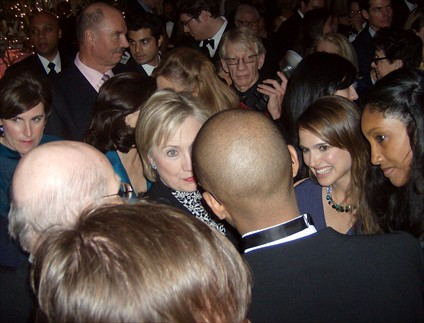 Hillary Clinton, Natalie Portman.  Background:  Henry Kissinger